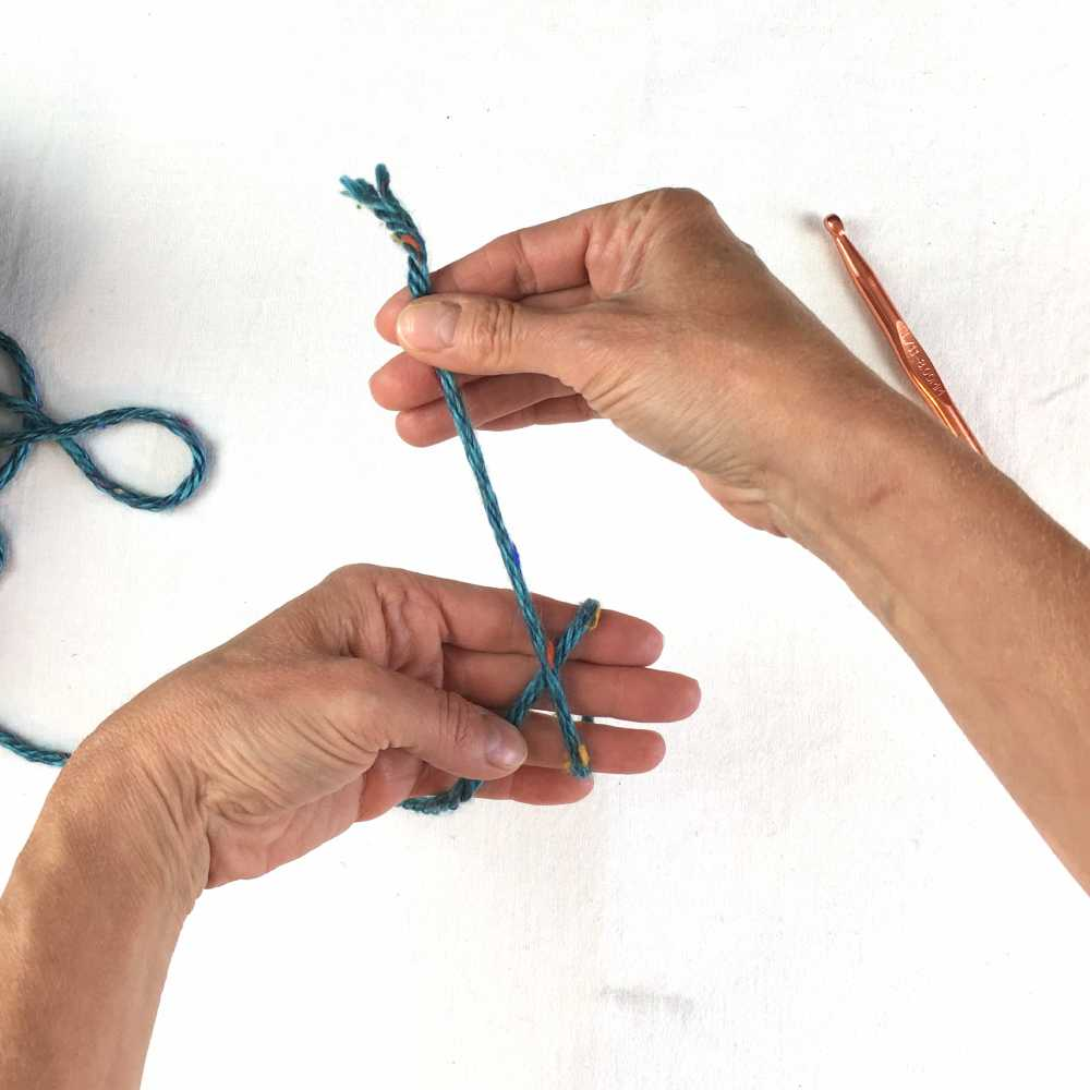 loop the yarn around fingers