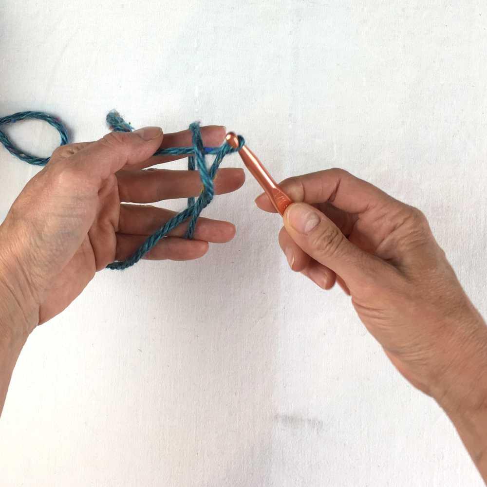 Pull yarn through loop with the crochet hook