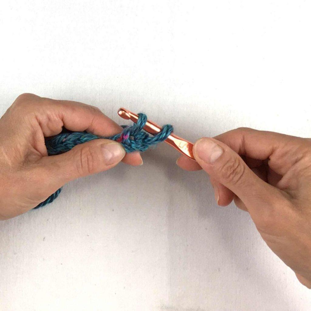 Two yarn loops on the crochet hook