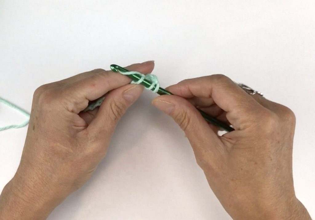 Grab the yarn with the crochet hook